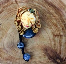 'Creative dreams' , polymer clay brooch with crystals. 9cm x 4 cm.