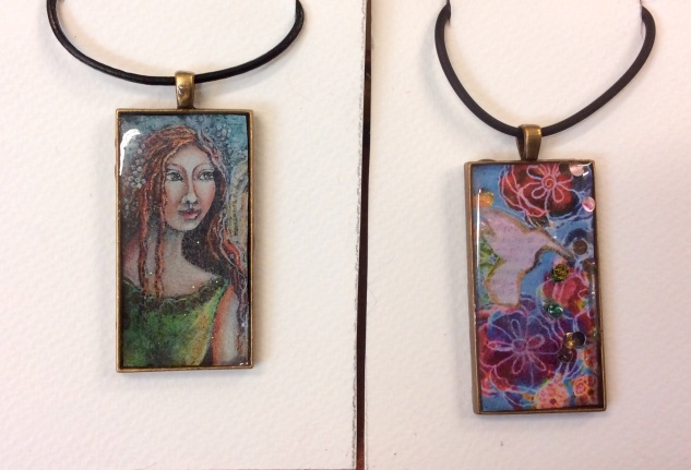 A couple of commercial bezel necklaces showcasing my original images.